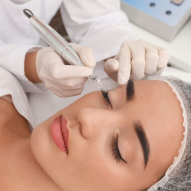 Young woman undergoing procedure of permanent eye makeup in tattoo salon, closeup